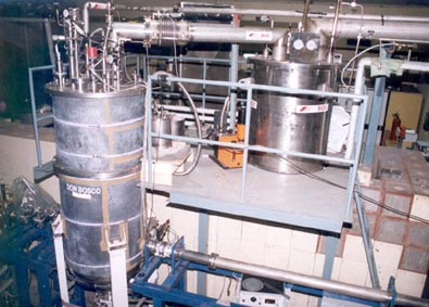 Buncher Cryostat integrated with LHe distribution network