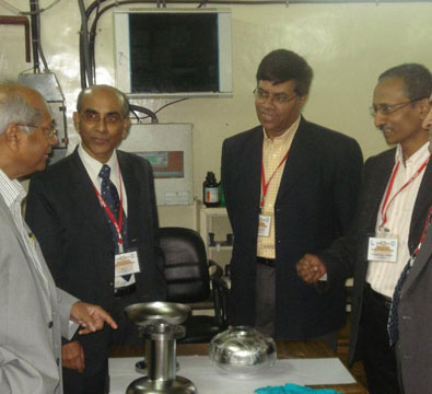 Visit by Dr Srikumar Banerjee, Chairman-DAE, to see the 1.3 GHz TESLA-type niobium cavities developed jointly by RRCAT and IUAC (February 2011).