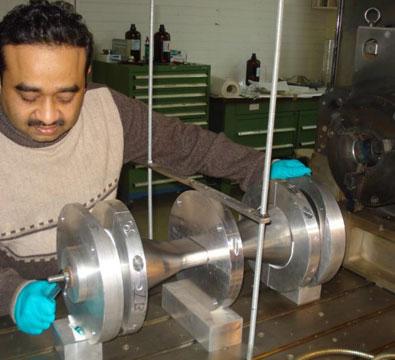 Niobium spoke assembly for the SSR1 single spoke resonator being setup for electron beam welding (February 2013).