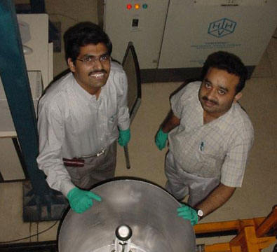 Central conductors from the QWR production at IUAC being set up for heat treatment (May 2007).